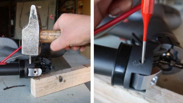 Mise en place de la goupille dans votre lock renforcé Xiaomi M365 puis à l'aide du marteau et du chasse goupille inséré la entièrement.
